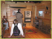 The Lodge in the Information Center.  The  Information Center has five open-captioned videos about the history of the Forest Service